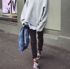 Oversized knit with jeans and Converse.