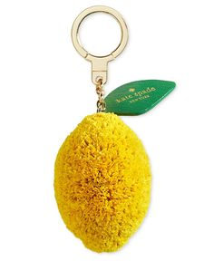 """Fresh and fun. kate spade new york adds fun to your keys with this adorably plush and posh lemon-themed keychain. 