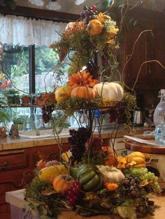 #Centerpiece for #Fall using moss, twigs and fall vegetables and flowers. Add votives to light during the evening. Made by Michelle Gergen designs. Autumn Centerpieces, Fall Decorating, Fall Topiaries, Pumpkin Topiary, Kitchen Island Vignette, Tiered Stand, Fall Displays, Elegant Fall Decor, White Pumpkins