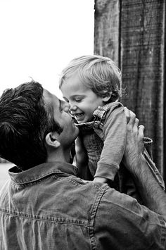 Daddy and child. One of my favorite b/w of all time.