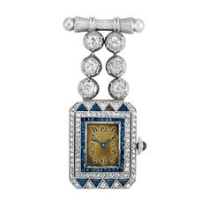 Art Deco Platinum, White Gold, Diamond and Sapphire Lapel Watch, Mappin   6 diamonds ap. .80 ct., dial signed Mappin, c. 1920, missing crystal, bar pin & diamond segment added later, ap. 12 dwt.