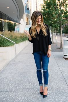 I love that the black top isn't too baggy but not too fitted, I love the ripped jeans with the black pointed heels to dress the outfit up.