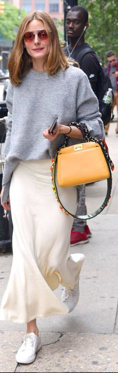 Who made  Olivia Palermo's pink sunglasses, gray sweater, orange handbag, white skirt, and sneakers?