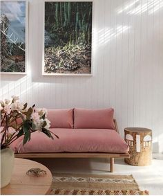 Pink velvet sofa surrounded by simplistic white finishes and natural woods