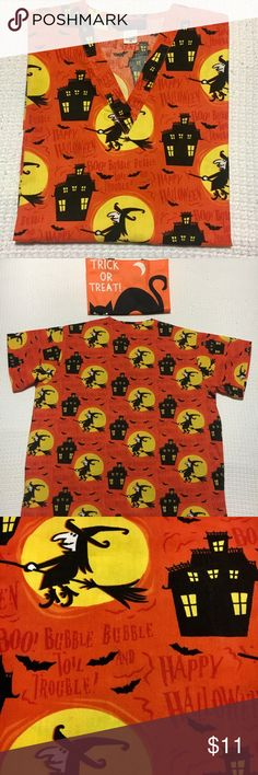 "Classic vintage print Halloween Scrub Top -medium Vintage print Halloween scrub top- ample sized  Medium. 29"" back of neck to hem- 24"" underarm to underarm. One of my favorites❣️Orange with black and yellow. Witches, bats and haunted houses🎃🎃👻👻 MEDWEAR brand . GUC. MEDWARE Tops"