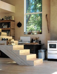 Awesome open Kitchen space~<3~Love the window, flooring and stairs.