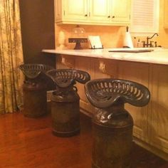 Old milk cans & tractor seats repurposed for bar stools
