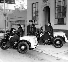 Jan. 17, 1955. The Vancouver Police Department is now using these two new three-wheeled motorcycles which replaced old three-wheelers last week. The new black-and-white machines are equipped with three-way radio, among other advanced devices, allowing the two meter officers to keep in touch with the station and other vehicles. Shown on the cycles are Patrolmen Ted Slothower (left) and Robert Irwin. Traffic Captain Harry O. Wood stands between the machines.  The Columbian Files