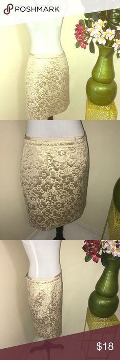 Loft Gold metallic floral pencil skirt size 10 The pictures do not show how sparkly dazzling and metallic the skirt is but the gold really shines and you will too if you decide to rock this! By Ann Taylor loft in size 10 in excellent condition,  note the exposed zipper in the back for a very modern look this is a lightweight peace and will look great with a crisp white shirt and a blazer or pair with black for contrast. Career or evening out the skirt is very versatile! Save money when you…