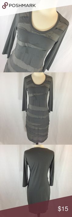 Taupe Merona tiered front knit dress I always get compliments on this dress! Super comfortable and stylish taupe color knit dress from Merona size small. 38.5 inches long, 18 inches armpit to armpit, 30 inch waist, 36 inch hip. Olive taupe color. Tiered fabric front. Merona Dresses Midi