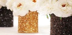 Love this idea! Cover tin cans in sparkles for wedding center pieces!
