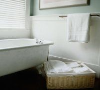 Feng Shui Bathroom tips. Other tips - Because the bath has several drains, be aware these are energy drains. Keep the lid on the toilet down, keep the bathroom door closed and small trash cans either covered or kept under the sink. Hang crystals to offset negative energies, keep drains covered. Make your bath a warm, inviting spa by adding candles, silk or live plants and scents that make you feel good when using this room. You can also check on line for cures for special problems.