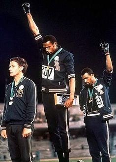 U.S. The Iconic Photo That Sent Shock Waves Throughout The World, 1968 Olympics. ~ The African-American athletes are Tommie Smith and John Carlos.