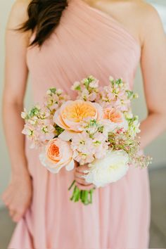 peach bridesmaid bouquet http://www.weddingchicks.com/2013/10/28/soft-and-sweet-wedding/