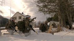 A unique look at U.S. and other NATO partner troops conducting an exercises involving taking an allied town from enemy forces as part of Cold Response 16 in Norway and with local Norwegians having a close-up look at the training engagement.