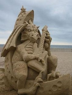 Sculptures like this one by Steve Topazio are made out of sand with extremely fine particles, which enhances adhesion and allows for details that seemingly defy gravity. Read more: Sand Castle Pictures - Gallery of Best Beach Art - Popular Mechanics Snow Sculptures, Sculpture Art, Metal Sculptures, Abstract Sculpture, Bronze Sculpture, Breathing Fire, Dragons, Castle Pictures, Ice Art