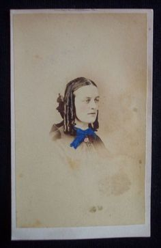 """You're bidding on a Civil War era photograph with tax stamp. The photographer is from Reading, Pennsylvania. The photograph measures 2.5"""" by 4""""."""