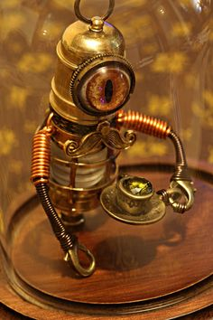 Little Steampunk Minion Robot Sculpture with Mustache holding a teacup in a Glass Dome Display