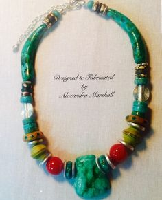"Fun and fabulous! Contemporary Tribal design necklace by Alexandra Marshall with artisan crafted clay and faux finished amber, turquoise focal and tusks. 16"" long with lobster clasp plus 3"" extender chain.piece #N2262. $169. To order double click on photo."