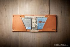 The Wild Bill Wallet by Mr.Lenz; All wallets will fit 3 to 4 credit cards on each side, 8 total. If you only need to fit medium and small sized euro bills, please select the Yen size. The Yen and Yuan wallet measures about 82mm x 101mm when folded.