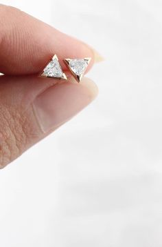 Our unique trillion earrings feature two large .15ct trillion-cut diamonds. Each diamond rests in a 14k gold prong setting, finished with a standard 14k post back. Simple yet distinct, these are the p