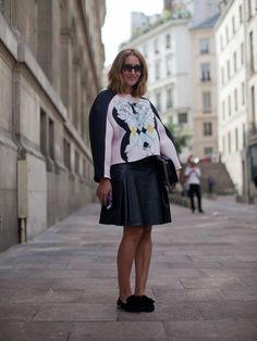 Street Style: Perfect match for Tiany Kiriloff with maxi sweater, mini leather skirt and black loafers at Paris Fashion Week, Spring 2014.