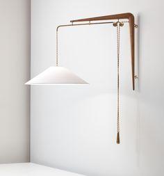 Gino Sarfatti, Adjustable wall light, model no. 137, 1938-1942. Tubular brass, brass, walnut, paper shade. Manufactured by Arteluce, Italy.