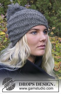 "Chinook - Knitted DROPS hat with spiral pattern in ""Nepal"" and ""Kid-Silk"" with pompom. - Free pattern by DROPS Design"