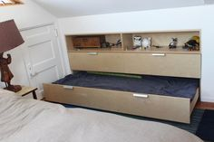 Trundle Bed in a Knee Wall. Design with drawers underneath & so foot of bed remains out from wall enough to act as a sofa, when bed is pushed in.