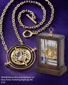 The Time-Turner™   An authentic recreation of Hermione's Time-Turner™ featured in the movie Harry Potter and the Prisoner of Azkaban™ . The Time-Turner™is centered with a working miniature hourglass and its inner rings rotate. Plated in 24 karat gold, measures 1 3/8 inches in diameter. Chain measures 18 inches. Comes complete with a display.