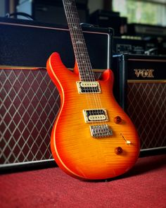This PRS SE Custom 22 sports a beveled maple top and flamed maple veneer, two humbuckers and a PRS-designed tremolo bridge. Make it yours at elderly.com. Electric Guitars, Bridge, Sports, Top, Hs Sports, Bridges, Sport, Crop Shirt, Bro