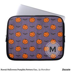 Kawaii Halloween Pumpkin Pattern Laptop Sleeve by NamiBear on Zazzle.com. This is a pattern of a smiling carved pumpkin with bats. The color of orange, purple, and black  adds to the feeling of fall and Halloween. The background has a texture that gives a bit of a grunge look. Your initial can be printed on this design.