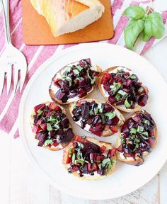 A toasted baguette is topped with goat cheese, balsamic roasted beets, fresh basil & balsamic reduction in this vegetarian Beet Bruschetta recipe that's perfect for Spring!