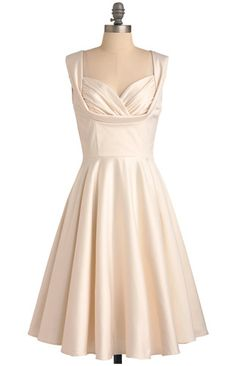 Aisle Be There by Trashy Diva has a gorgeous neckline that's a little daring (perfect for Vegas)...but not TOO much so! The soft off-white color is very classy. $162.99  More options: http://www.littlevegaswedding.com/2013/04/budget-short-wedding-dresses-for-vegas/