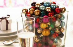 What to do with all the baubbles that have their string broken - put them in a vase on display.