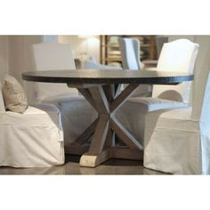 Round wood dining table with zinc top