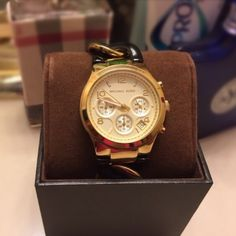 Michael Kors chain link gold& black watch Classy authentic Michael Kors chain link,gold& black Chronograph watch.Used only about 2 or 3 times,as good as new,in good working condition,without tag,comes with box& booklet.No links removed. Michael Kors Accessories Watches