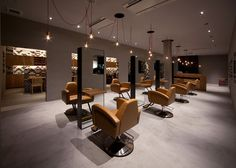 Hiroyuki Miyake used a traditional English bricklaying pattern for the ceramic tiles on the walls of this beauty salon in Toyokawa, Japan.