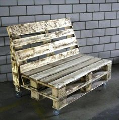 In this picture a simple rustic pallet bench simple is shown which is placed on the floor, And it looks beautiful because of its simpleness. Under the bench the wheels are attached to make it movable, and you can move it anywhere in the house where you want easily. So, you can make this DIY project in your home with using the plans and the tips of the pallet wooden ideas.