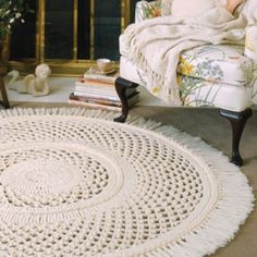 "This lovely, large, and lacy Picot Rug would make a beautiful addition to your home decor. Edged with fringe and accented with braids, it is crocheted using three strands of worsted weight yarn and sizes N (9.00 mm) and Q (15.50 mm) hooks. Number of Designs: 1 rug Approximate Design Size: 60"" diameter"
