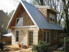 This is a tiny strawbale guest cottage/apartment in Virginia, outside of Washington DC. It measures in at 12-feet x 17-feet inside, and includes a kitchen, a full bath with a tub, a living space and a loft bedroom with plenty of storage under the dormers. We built it on a tiny budget by building on an existing 1-car garage slab foundation, using a ton of salvage materials, and using strawbales & clay soil for the walls.