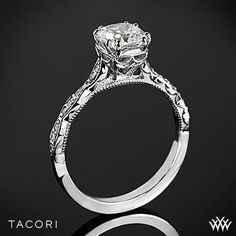 The ceiling of this cushion cut Tacori Engagement ring is dressed to the nines in diamonds. Unique marquis shaped designs create a sparkling mega diamond look along the band. #Tacori #Whiteflash