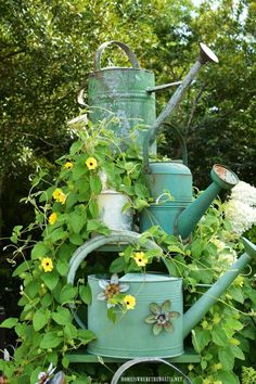 Trellis and Favorite Summer Vine Ladder trellis for Black-eyed Susan vine with watering cans Garden Ladder, Garden Trellis, Herbs Garden, Fruit Garden, Garden Planters, Vine Trellis, Tomato Garden, Garden Gates, Fast Growing Flowers