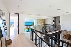 """This home is situated in Malibu, California. The proximity to the Pacific Coast Highway and being located on the """"Main Street"""" in Malibu makes Natural Stone Cladding, Malibu Beach House, Malibu Homes, Dream Beach Houses, Malibu Beaches, Entry Hallway, Beautiful Interiors, My Dream Home, Luxury Homes"""