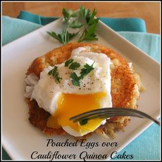 Poached Eggs Over Cheesy Cauliflower Quinoa Cakes