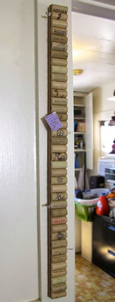 Wine Cork Synthetic Cork Vertical Corkboard by LMadeIt on Etsy, $35.00...BUT you could make one by gluing the wine corks in same manner to a yardstick and hang it. Cool idea!!!