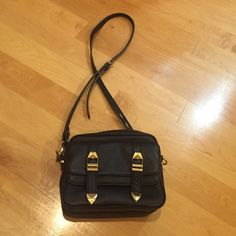 Rebecca mink off cross body bag Great condition ; has many compartments ! Hardware still nice no stains or rips.  Very versatile bag Rebecca Minkoff Bags Crossbody Bags
