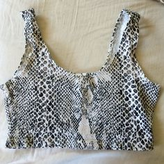 American Apparel snake print crop top tank bra Used once and in great condition.  The color is white with gray and black snake print. Size Small. Pet and smoke free home. It's a tank top crop top. Can be used for yoga or other things as well. American Apparel Tops Tank Tops