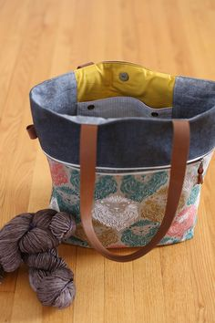 genius knitting bag.  grommets for yarn guides, built in needle storage, and big pockets!