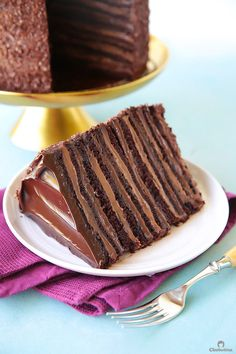 Epic 12 Layer Chocolate Cake Twelve layers of chocolate cake filled with alternating layers of silky chocolate pastry cream and rich fudgy chocolate frosting. This tall mega cake might just be the best chocolate cake you'll ever taste. Chocolate Pastry, Best Chocolate Cake, Chocolate Frosting, Molten Chocolate, Russian Honey Cake, Russian Cakes, Russian Desserts, Huge Cake, Buckwheat Cake